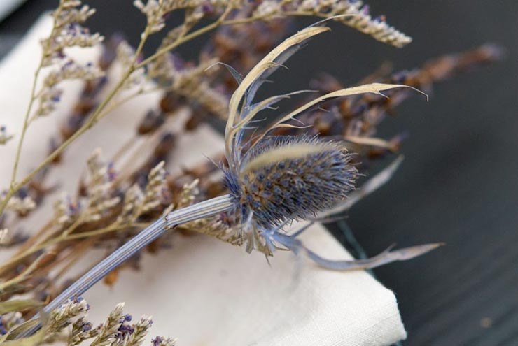 A closeup of thistle and lavender tied to a napkin.
