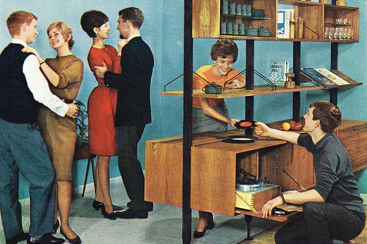 A 1950's party with 2 couples dancing and 2 people selecting records to play.