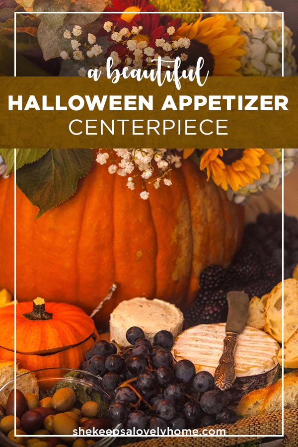 Serve this beautiful Halloween appetizer centerpiece with cheese, olives, prosciutto, fruit and veggies at your next Halloween party! #halloween, #cheeseplate, #appetizers, #flowers, #cheese