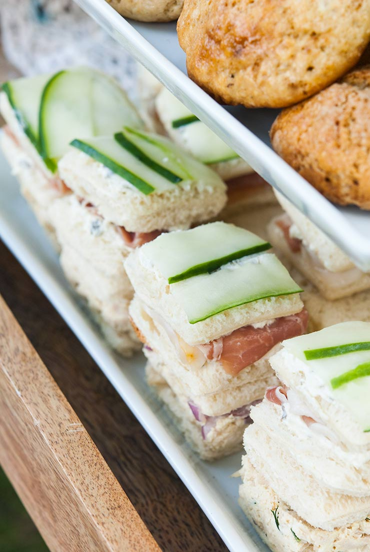 cucumber sandwiches on a tray.