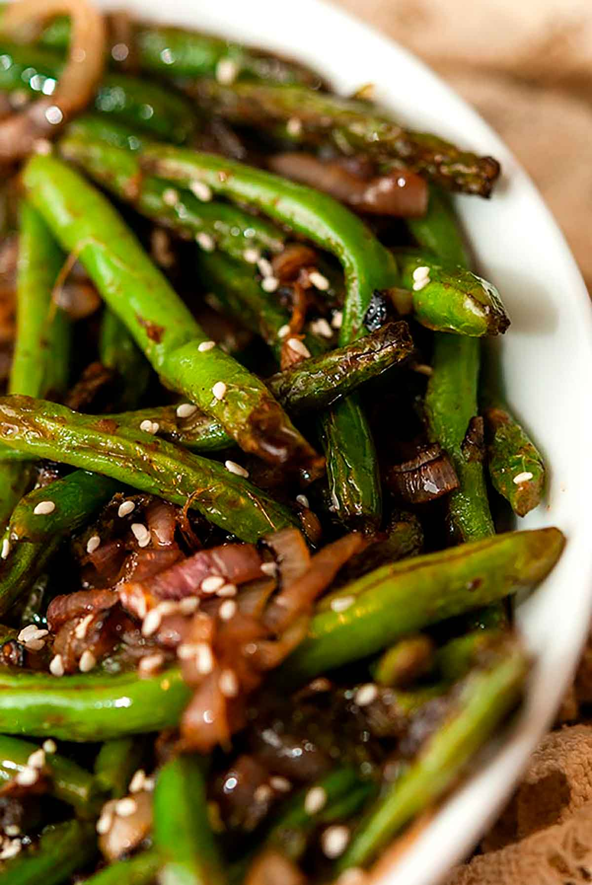 A bowl of blistered French green beens and shallots.