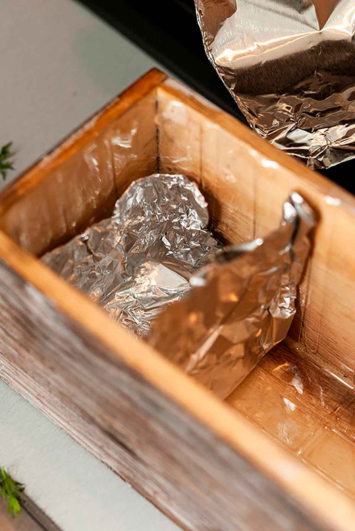 A flower box with a tin foil divider.