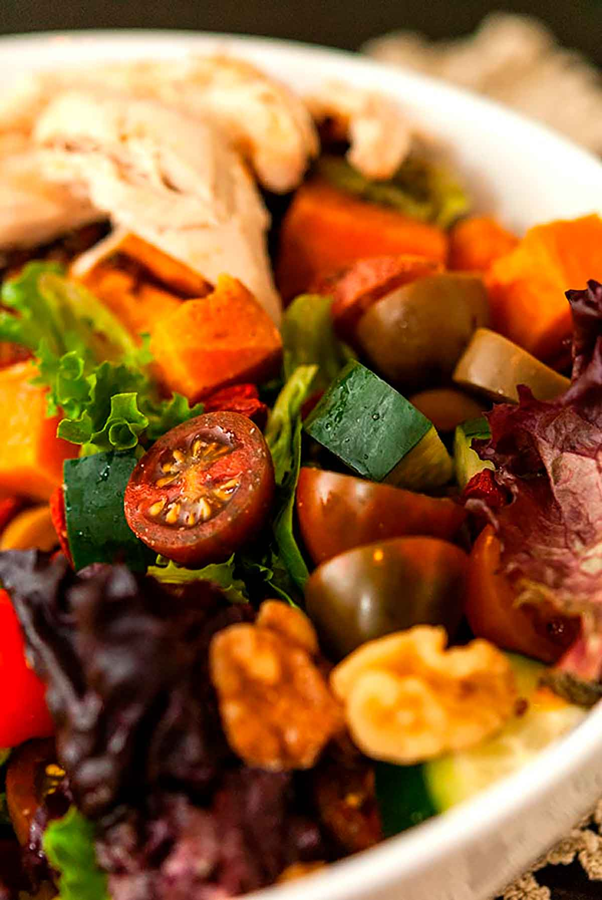 A colorful salad with many assorted vegetables.