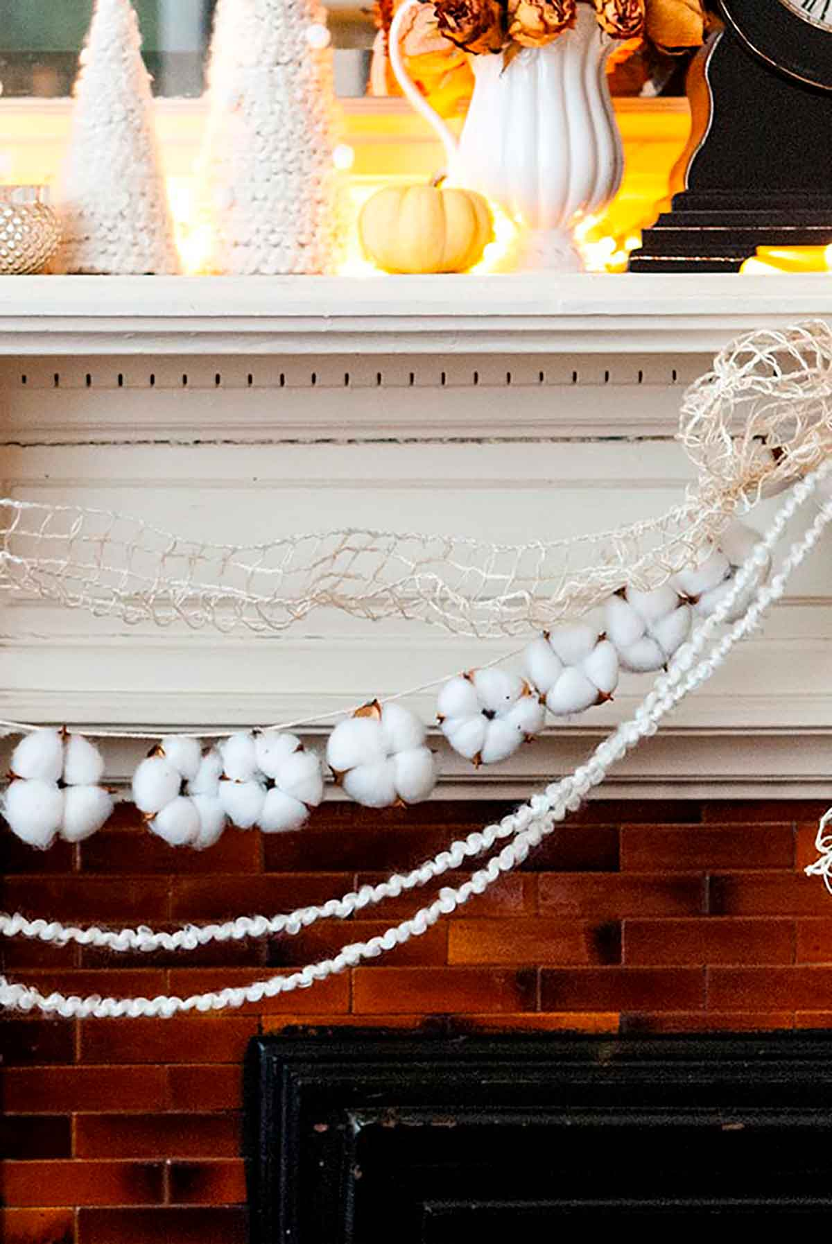 Cotton garland strung on a mantle with yarn and ribbon.