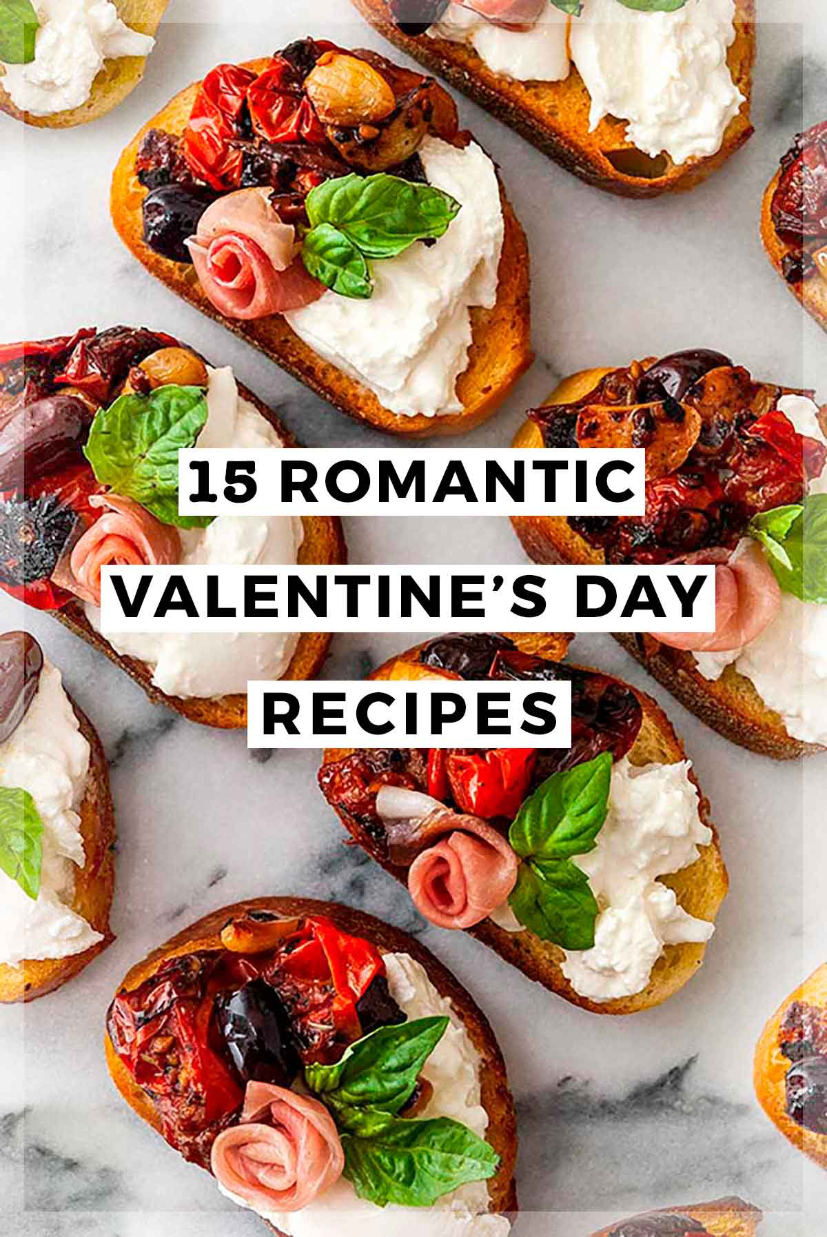"""Ornate appetizers on marble with a title that says """"15 Romantic Valentine's Day Recipes."""""""