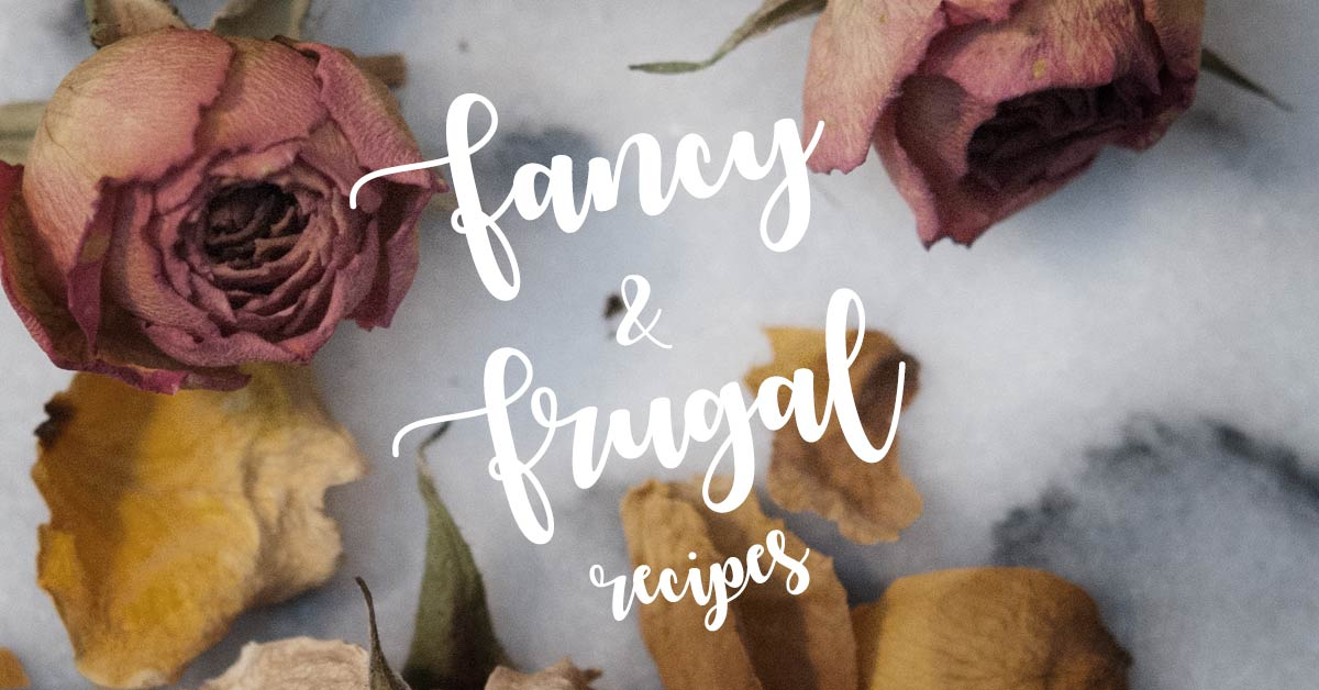 "A title that says ""Fancy & Frugal"" on a marble background with dry flowers."