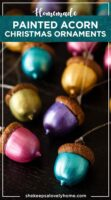 12 painted acorn ornaments on a table, in different colors.