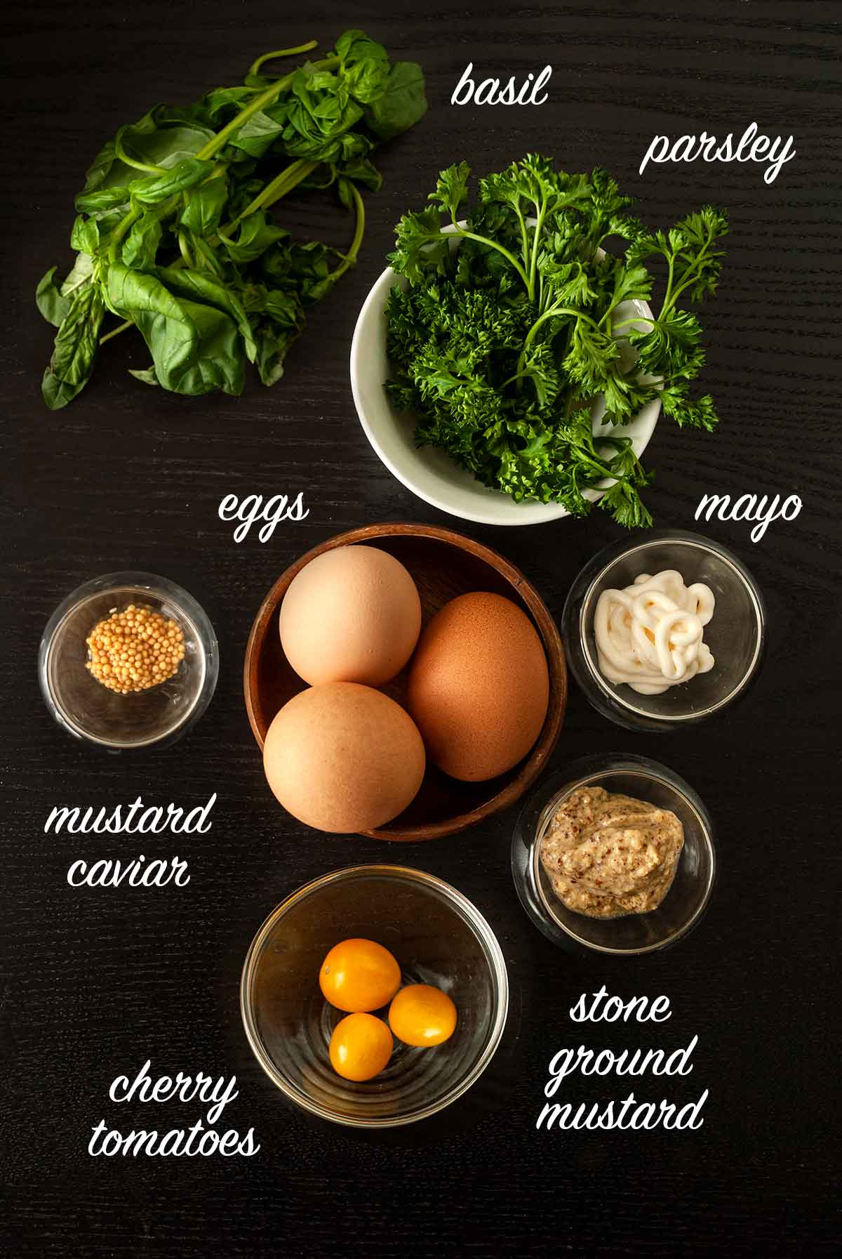 A group of ingredients on a black table with text labels.
