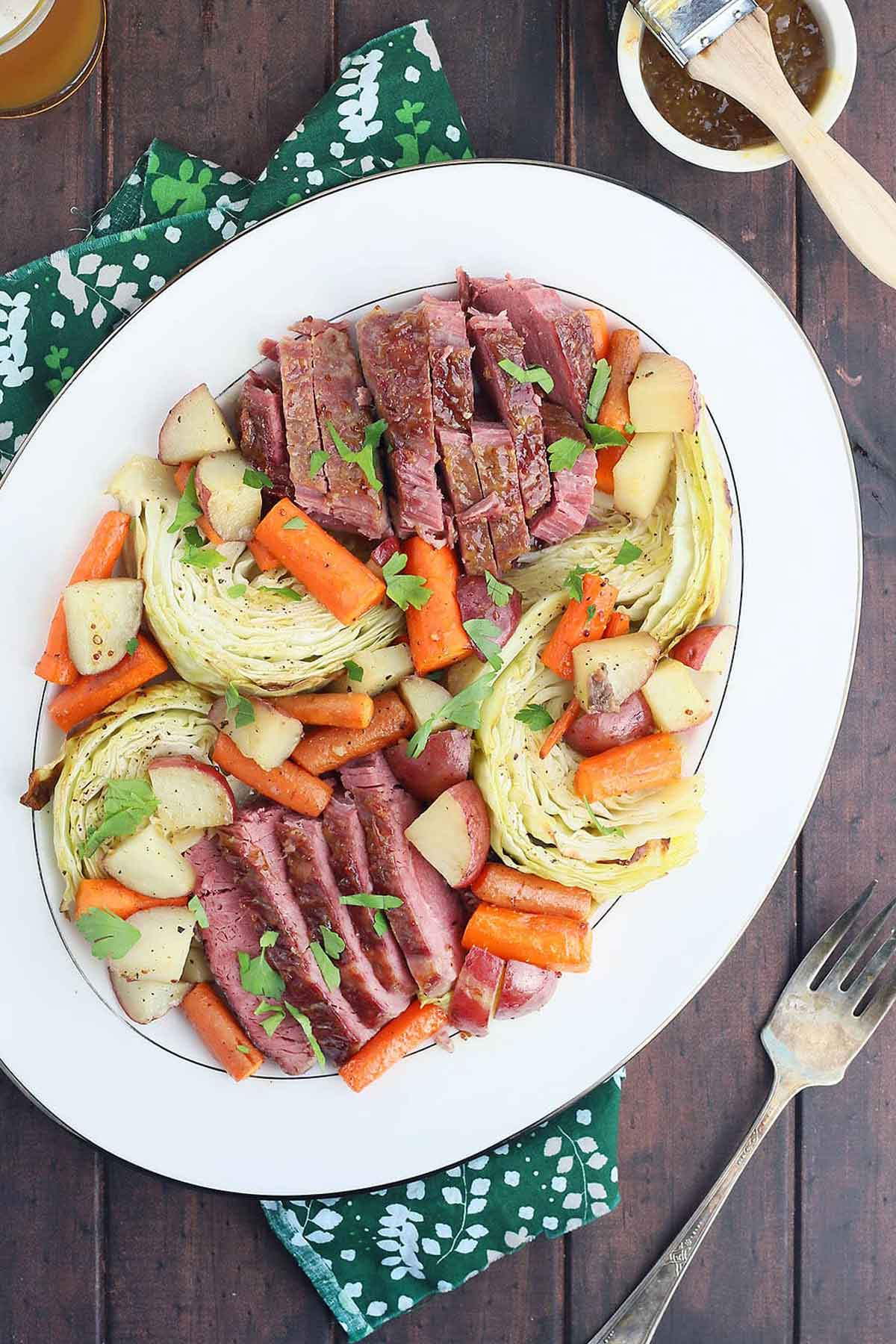 A large serving plate of corn beef and cabbage.