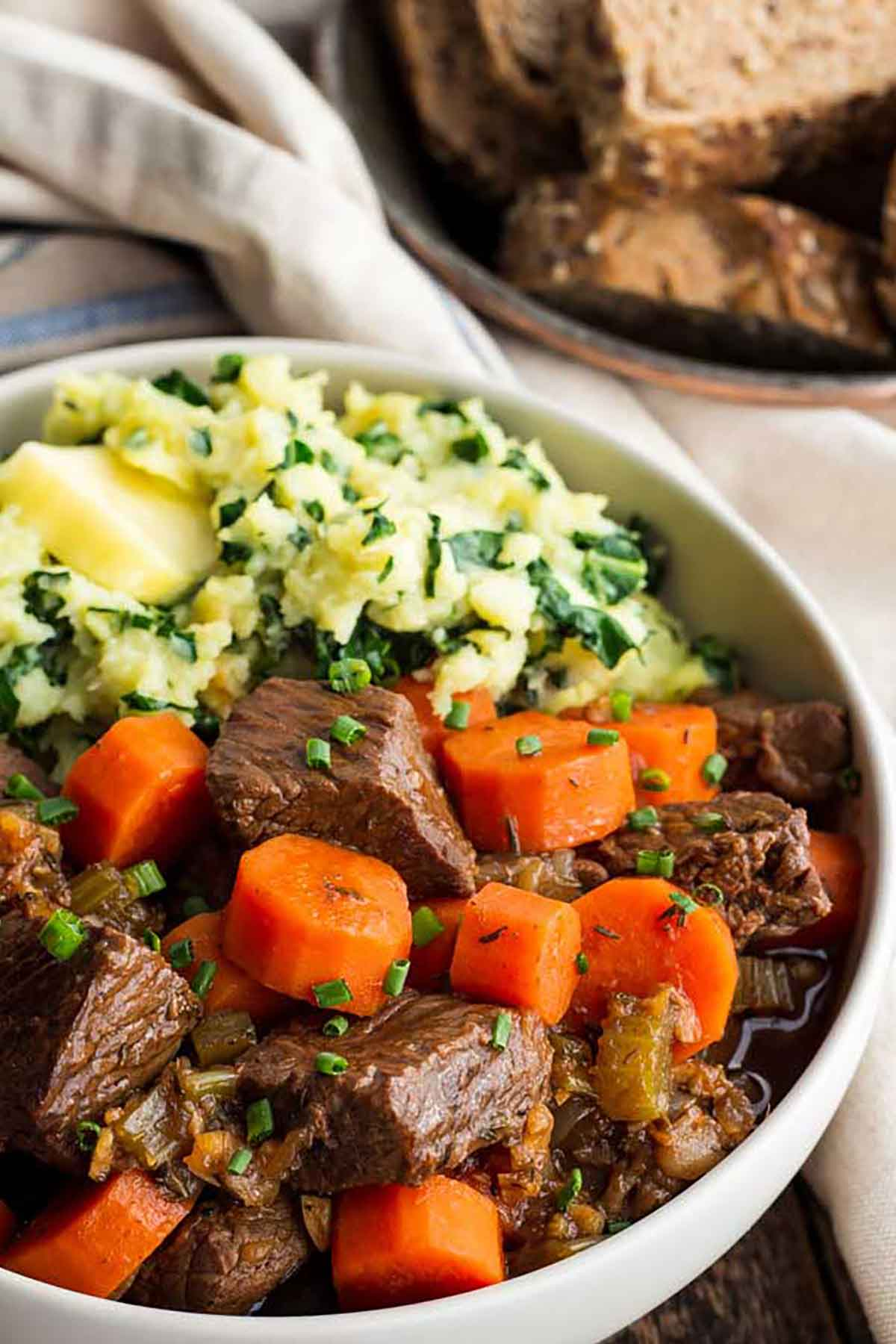 A bowl of Guinness beef stew with carrots.