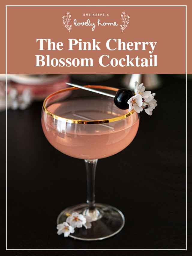 "A pink cocktail with a title that says ""The Pink Cherry Blossom Cocktail."""