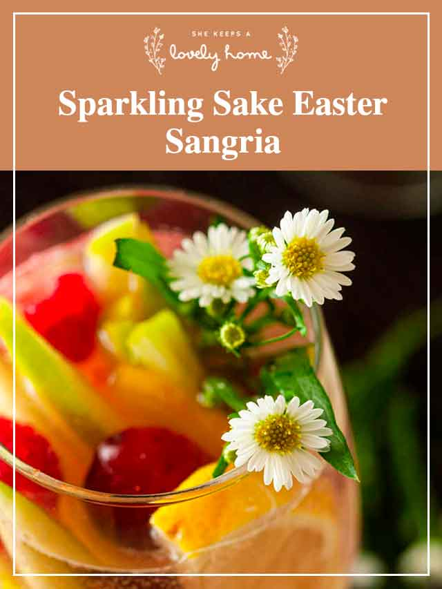 The daisy and fruit garnish in a glass of sake sangria.