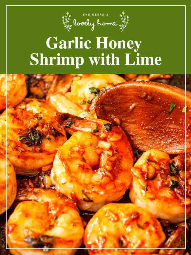 """Shrimp in a pan with a spoon and a title that says """"Garlic Honey Shrimp with Lime."""""""