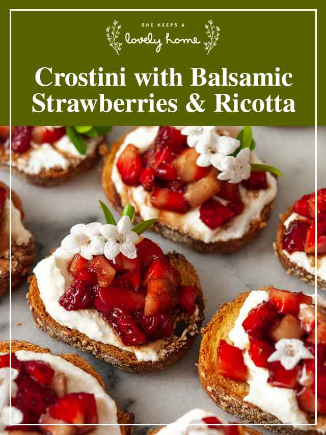 """8 strawberry crostini on marble with a title that says """"Crostini with Balsamic Strawberries & Ricotta."""""""