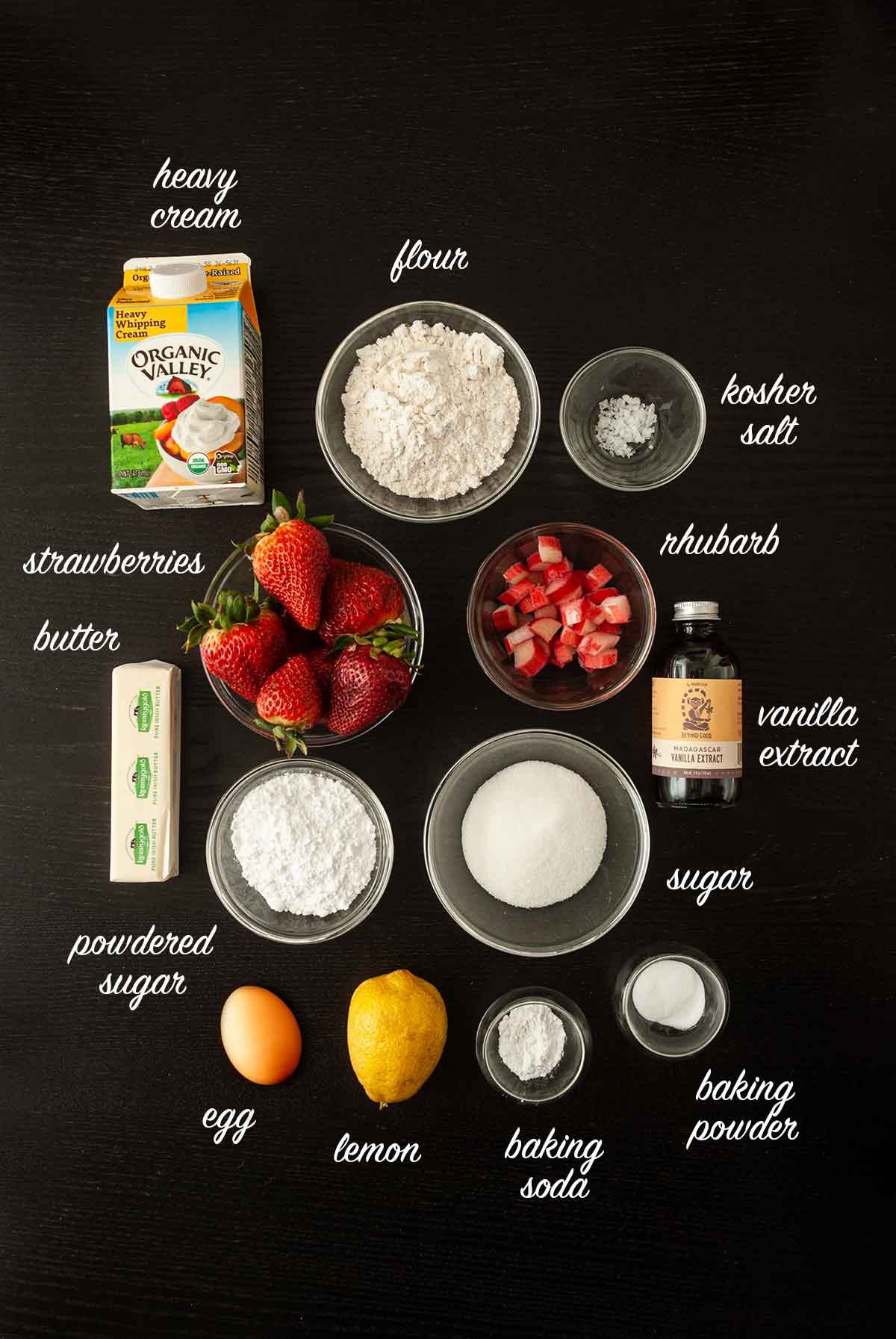 Ingredients on a dark table with titles for each ingredient.