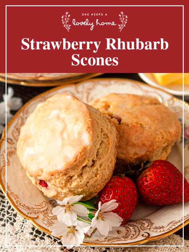 "2 scones on a plate with strawberries and a title that says ""Strawberry Rhubarb Scones."""
