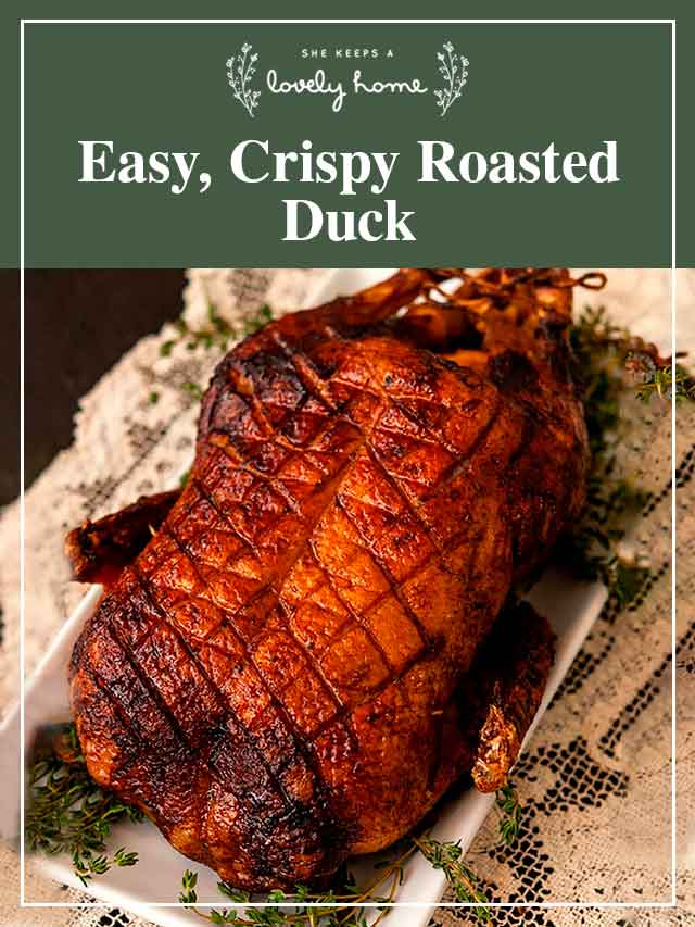 "A roasted duck on lace table cloth with a title that says ""Easy, Crispy Roasted Duck."""