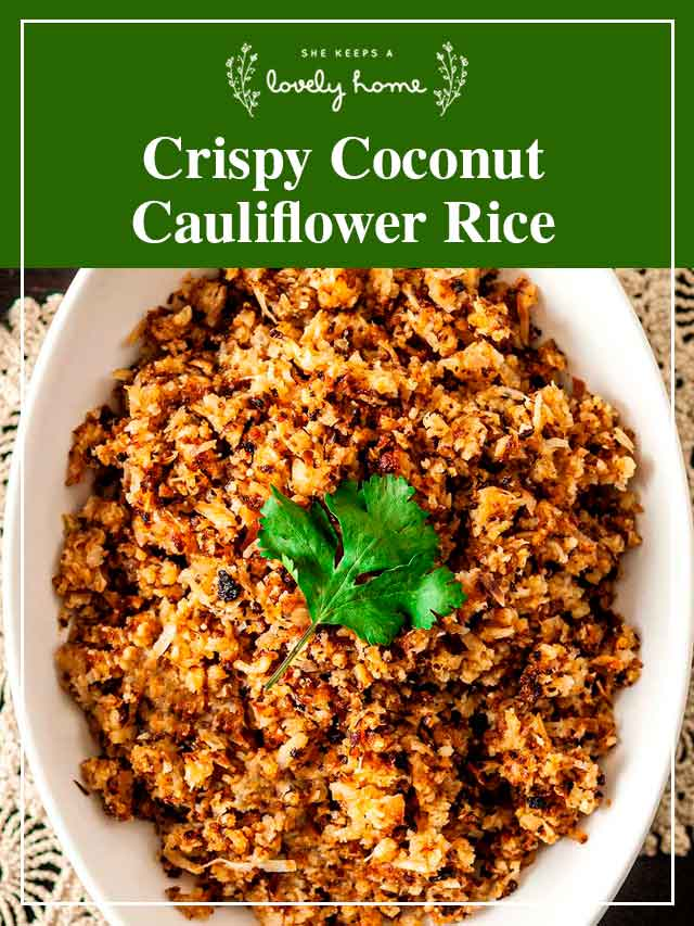 """Coconut cauliflower rice in a bowl with a parsley leaf on top and a title that says """"Crispy Coconut Cauliflower Rice."""""""