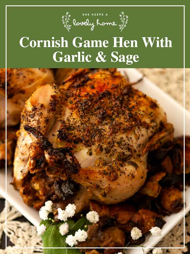 """A cooked Cornish Game hen on a plate with flowers and a title that says """"Cornish Game Hen with Garlic & Sage."""""""