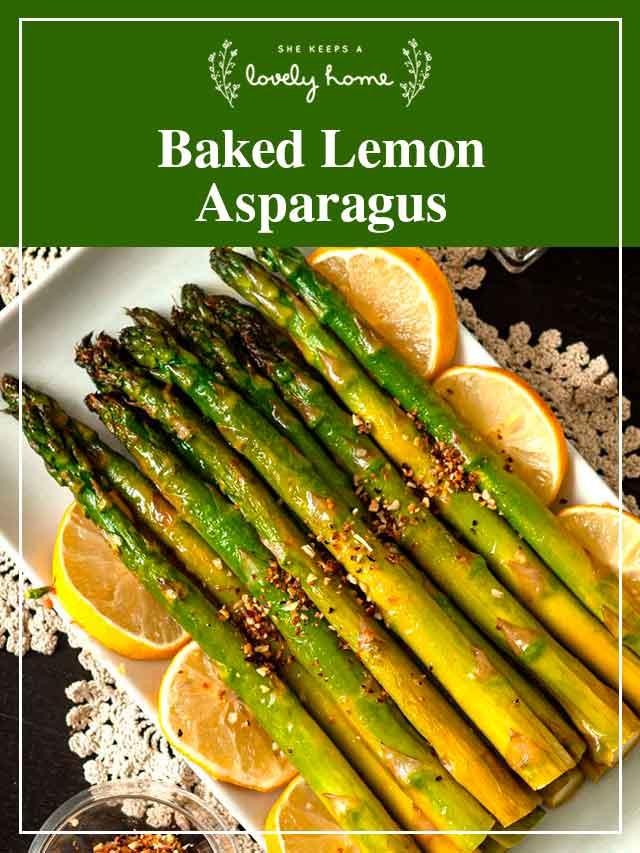 "Asparagus on a plate with lemon slices and a title that says ""Baked Lemon Asparagus."""
