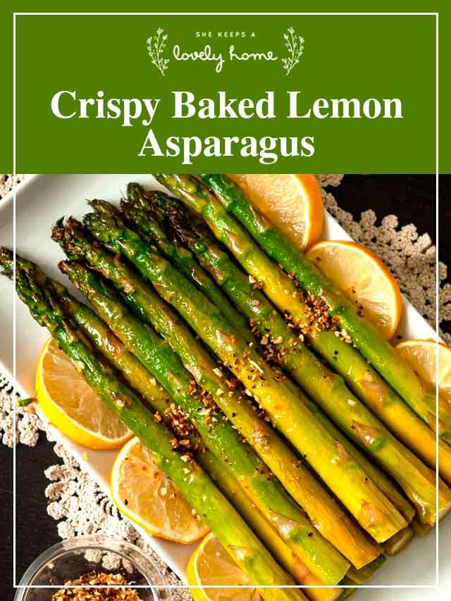 "Asparagus on a plate with lemon slices and a title that says ""Crispy Baked Lemon Asparagus."""