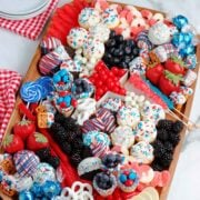 A try filled with red white and blue dessert treats on a table.