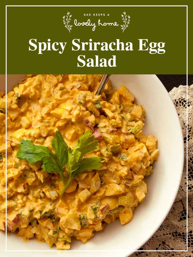"""Spicy egg salad in a bowl with a title that says """"Spicy Sriracha Egg Salad."""""""