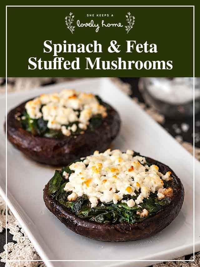 """2 stuffed mushrooms on a plate with a title that says """"Spinach & Feta Stuffed Mushrooms."""""""