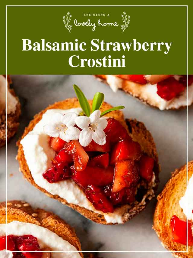 """A crostini with strawberries and flowers with a title that says """"Balsamic Strawberry Crostini."""""""