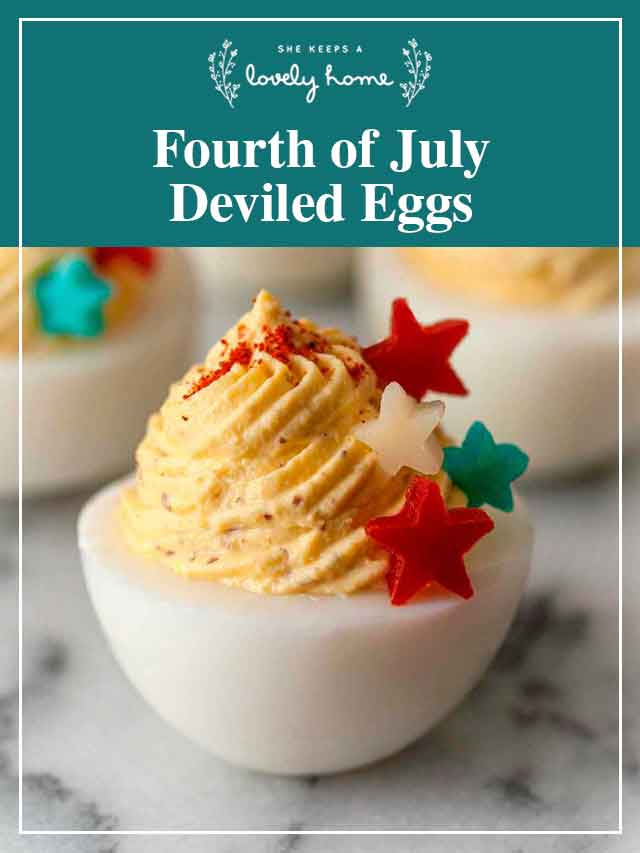 """A deviled egg, garnished with 4 stars and a title that says """"Fourth of July Deviled Eggs."""""""
