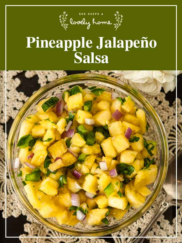 """Pineapple jalapeño salsa in a small bowl on a lace tablecloth with a title that says """"Pineapple Jalapeño Salsa."""""""