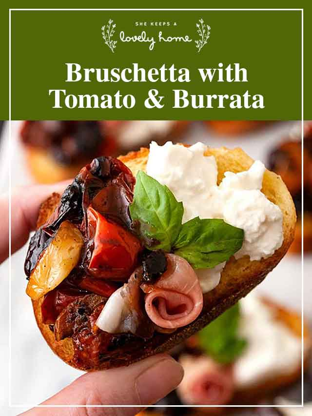 """Fingers holding bruschetta with a title that says """"Bruschetta with Tomato & Burrata."""""""