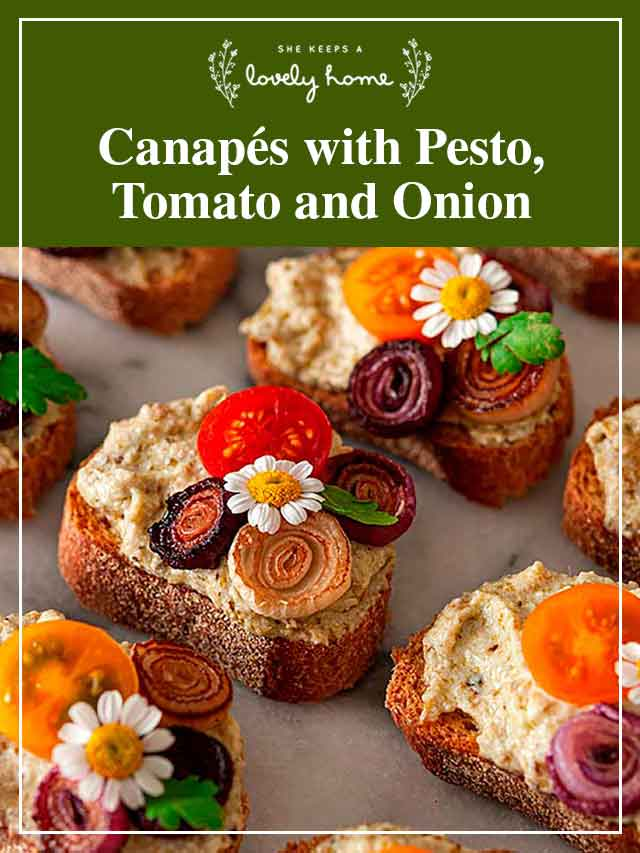 """7 ornately garnished canapés with a title that says """"Canapés with Pesto, Tomato and Onion."""""""